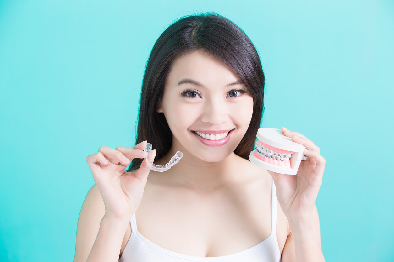 Woman Choosing ClearCorrect Aligners Over Traditional Braces